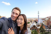 Happy travel couple in Park Guell, Barcelona — Stock Photo