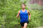 Sport running fitness man training towards goals — Stock Photo