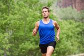 Sport running fitness man training towards goals — Stock Photo