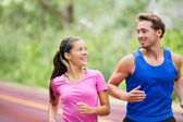 Healthy lifestyle - Running fitness couple jogging — Stock Photo