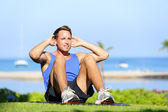 Man exercising sit-ups outside — Stock Photo