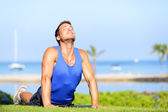 Fitness yoga man in cobra pose stretching abs — Stock Photo