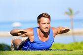 Fitness man training back extension exercise — Stok fotoğraf