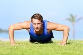 Push-ups - fitness man training push up outside — Stock Photo