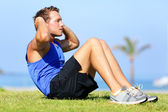 Sit-ups - fitness man training sit up outside — Stock Photo