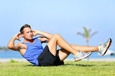 Sit ups - fitness man exercising sit up outside — Stock Photo
