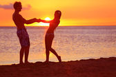 Romantic couple fun on beach sunset during travel — Stock Photo