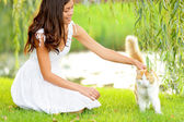 Woman petting cat in summer park — Stock Photo