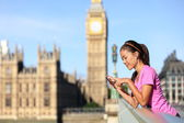 London lifestyle woman listening to music, Big Ben — Stock Photo