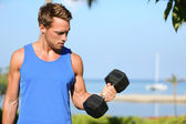 Bicep curl - weight training fitness man outside — Stock Photo