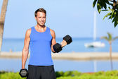 Fitness bicep curl - weight training man outdoors — Stock Photo