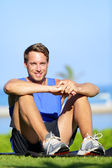 Fitness sports athlete man relaxing after training — Stock Photo