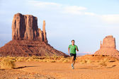 Runner - Running man sprinting in Monument Valley — Stock Photo