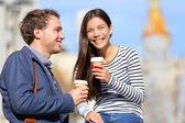 Happy couple drinking coffee talking — Stock Photo