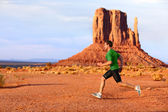 Running man sprinting in Monument Valley — Stock Photo