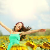Happy woman in sunflower field — Stock Photo