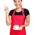 Waitress pointing holding coffee — Stock Photo