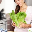 Woman preparing salad - Stock Photo