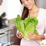Woman preparing salad — Stock Photo #21562329