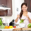 Woman making salad — Stock Photo #21562361