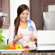 Cooking woman using computer — Stock Photo #21562365