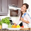 Woman in kitchen making food happy — Foto Stock
