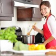 Cooking woman in kitchen — ストック写真
