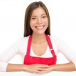 Apron woman sales assistant clerk — Stock Photo
