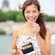Paris woman eating macaron — Stock Photo