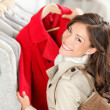 Shopping woman in clothes shop — Stock Photo