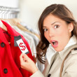 Shopping woman shocked over price — ストック写真