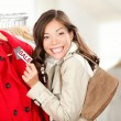 Shopping woman at clothes sale — Stock Photo #21563003