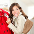 Shopping woman at clothes sale - Stock Photo