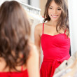 Woman trying on dress — Stock Photo