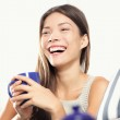 Woman laughing drinking tea — Stock Photo #21563653