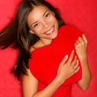 Love woman showing red heart — Stock Photo