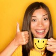 Woman drinking coffee happy thumbs up — Stock Photo