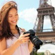 Paris tourist with camera - Stock Photo