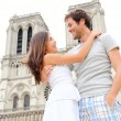 Notre Dame de Paris - happy couple — Stock Photo