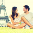 Travel tourists couple at Eiffel Tower Paris — Stock Photo #21564367