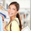 Shopping woman showing credit card - Stock Photo