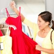 Woman shopping buying clothing - Stock Photo