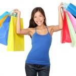 Shopping woman holding shopping bags — Stock Photo