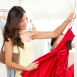 Woman shopping for dress — Stock Photo #21564613