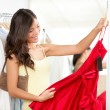 Woman shopping for dress — Stock Photo