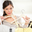 Shopping woman trying clothes — Stock Photo