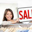Shop owner sale sign - Stock Photo