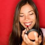 Woman putting makeup lipstick — Stock Photo