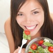 Woman eating healthy salad — Stock Photo