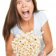 Woman scared funny watching movie — Stock Photo